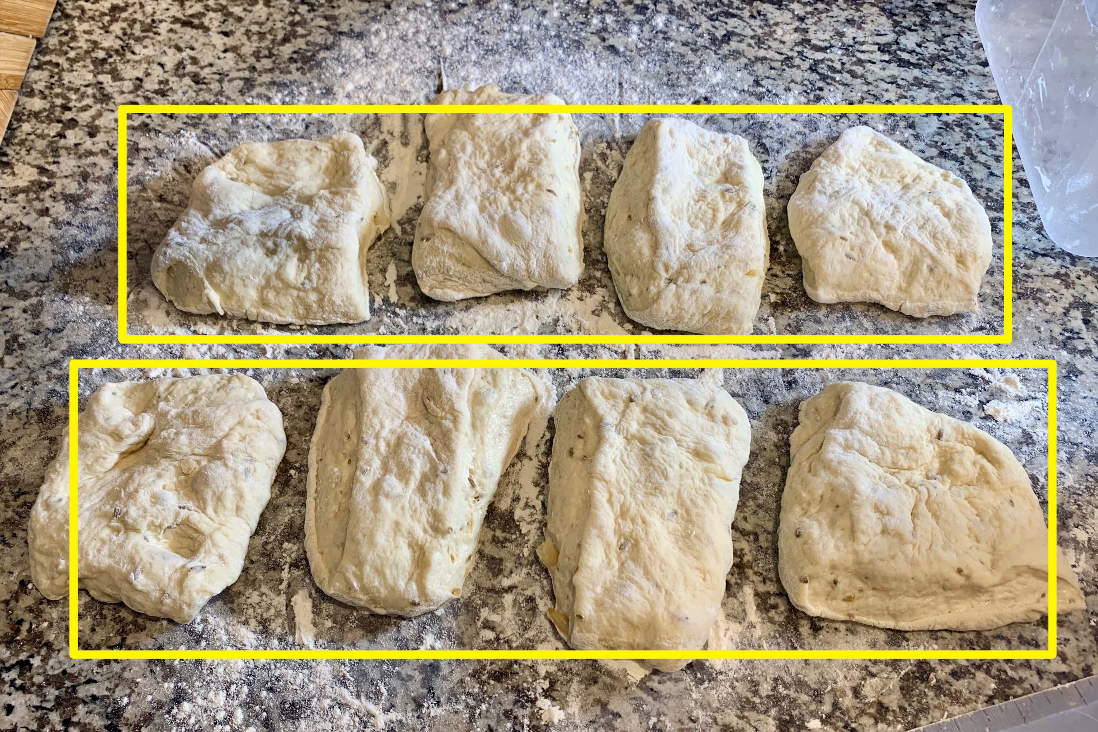 the flattened ciabatta dough cut into 8 equal pieces lies on the counter. overtop the image has been drawn two large, horizontal yellow rectangles showing that you can cut the dough lengthwise two long loaves instead.