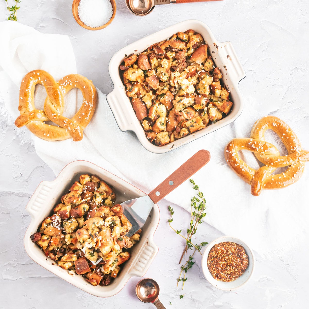 two small dishes of pretzel stuffing