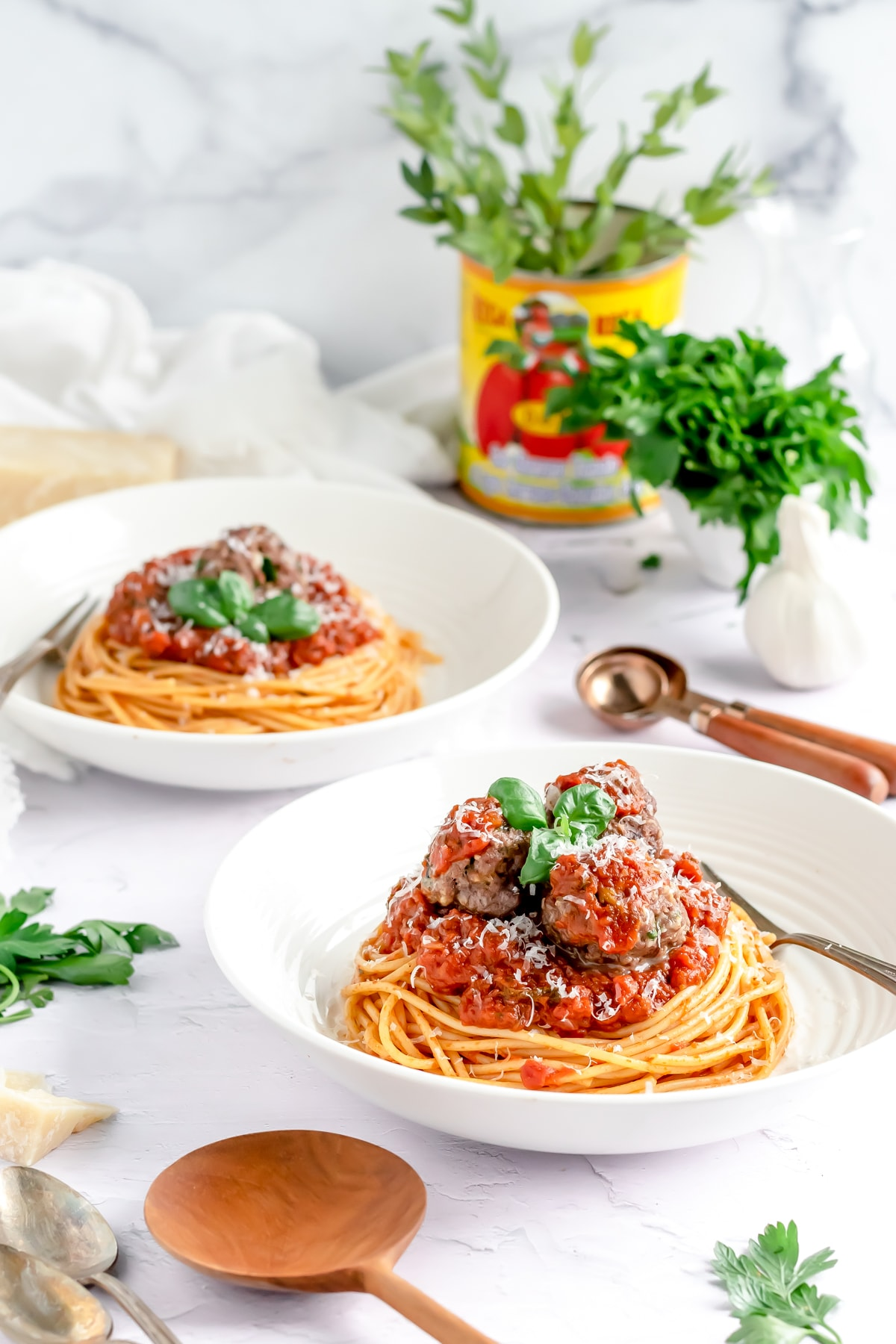two bowls of spaghetti and meatballs
