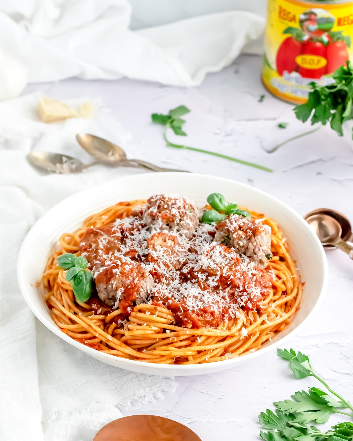 a serving bowl of spaghetti and meatballs