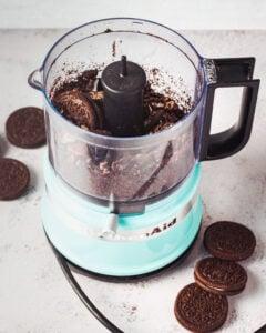 mini food processor with ground oreo cookies inside