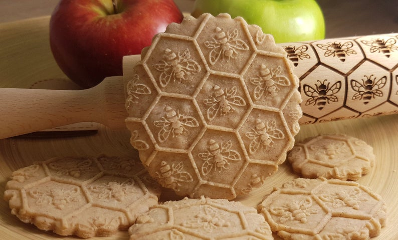 honeybee embossed cookie leaning on a rolling pin