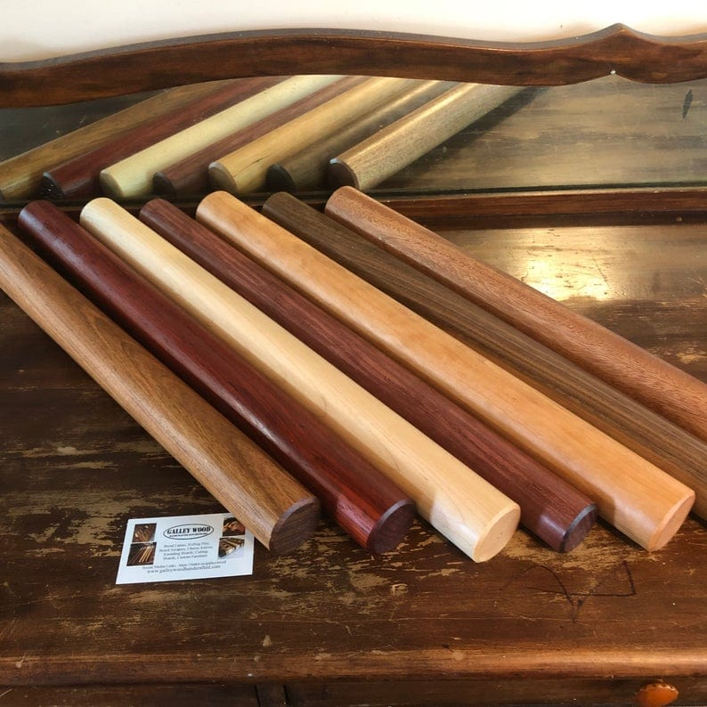 6 wooden dowel rolling pins in a variety of wood types