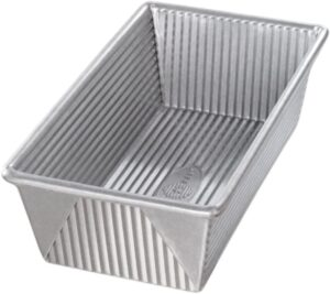 a silver rippled loaf pan with sharp, crisp corners
