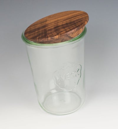 a glass weck jar with a wooden lid on top