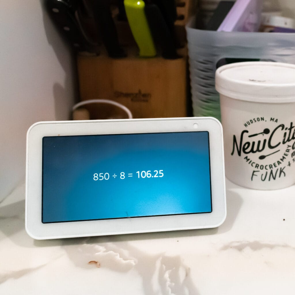 an echo show displaying an equation 850 divided by 8 equals 106.25