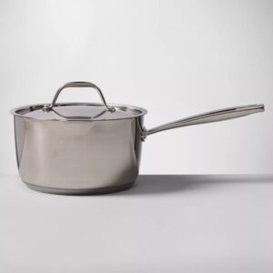 a stainless steel sauce pot with metal lid and handle