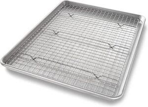 a silver sheet pan with a cooling rack nested inside