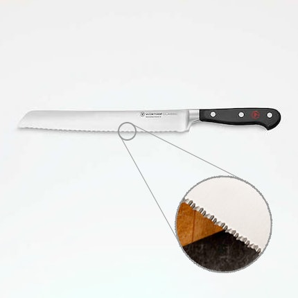 wustof classic serrated bread knife with a close up of the double serrated edge